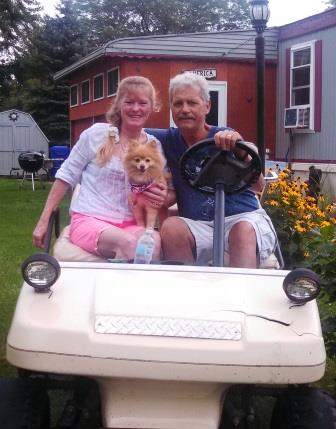 Herb, a liver recipient, with his wife Bobbie and Foxy, a Pomeranian.