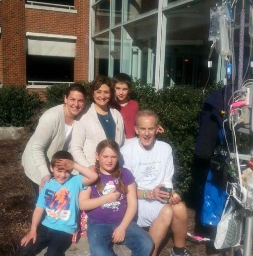 Fred photographed outside the hospital with his family.